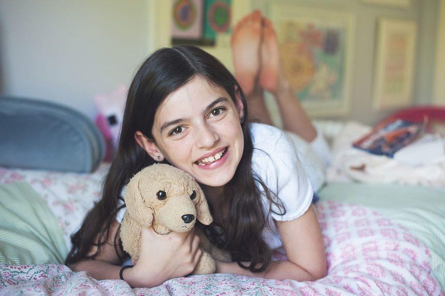 Photographers in Greensboro NC with tween girl with stuffed dog