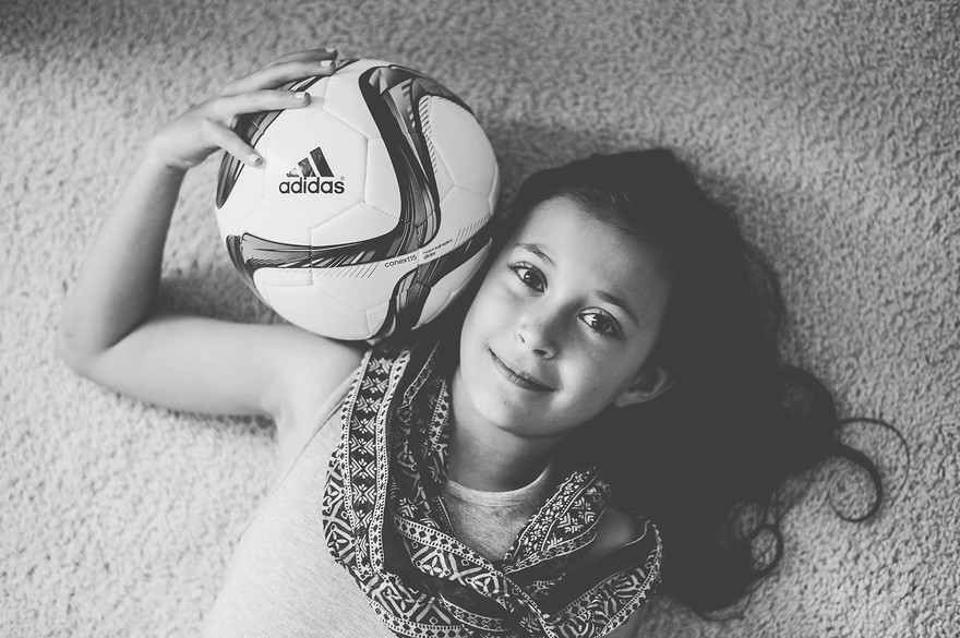 Photographers in Greensboro NC with tween girl with soccer ball